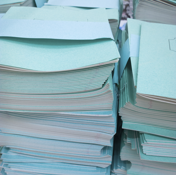 pile of notebooks and papers