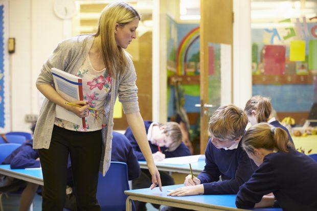Teacher talking to pupils in classroom