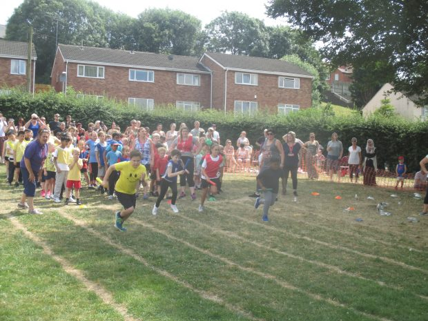 Primary school children sprinting in PE lesson