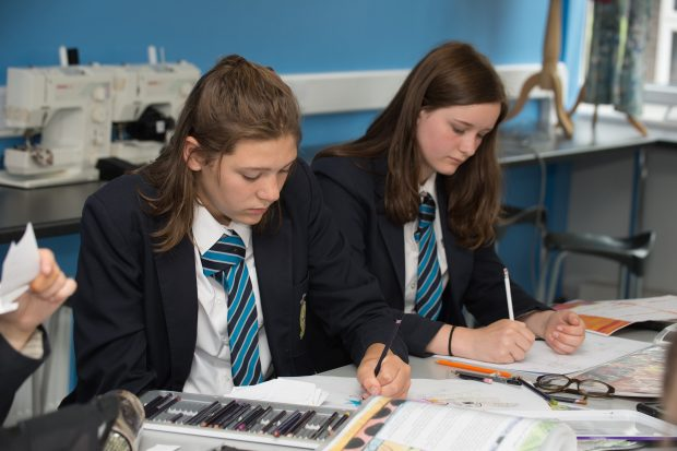Two pupils working in class