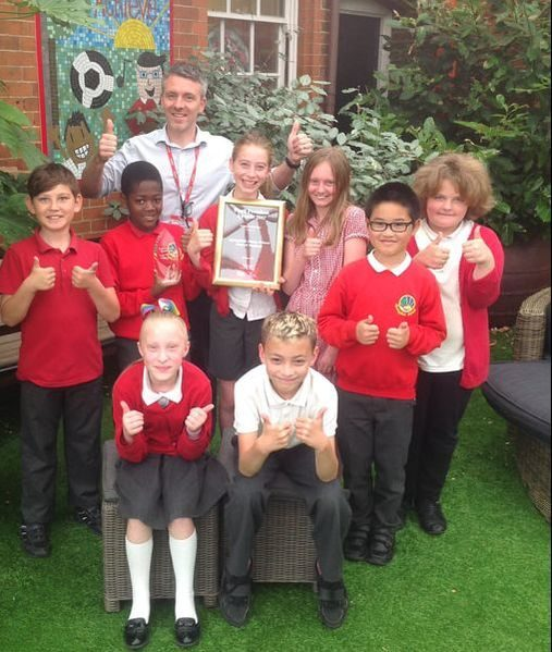 Pupils and the headteacher from Springfield Junior School posing with their Pupil Premium Award