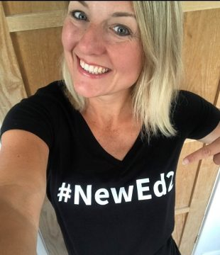 Emma Turner wearing a t shirt that says #NewEd2