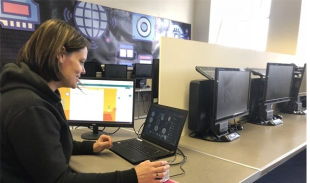 Karen Morris working on a laptop in a computer suite
