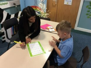 Academic mentor working with young boy