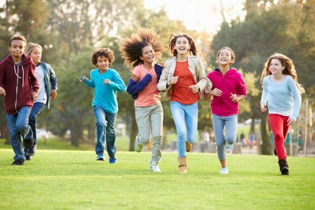 Group of children running outside